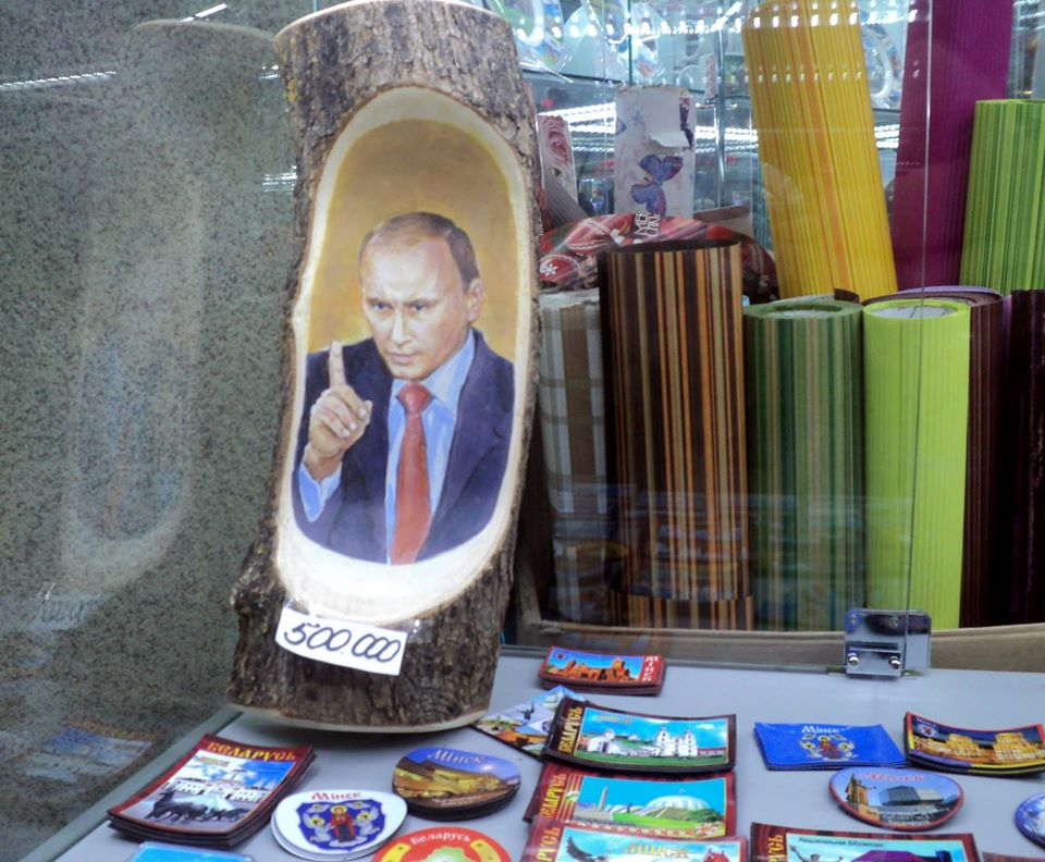 A wooden Putin vs. fridge magnets with Belarusian symbols at a Minsk souvenir shop